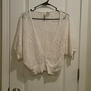 Off white crocheted cardigan.